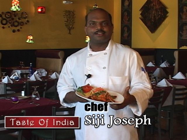 Chef Siji Joseph prepares the Chili Garlic Shrimp